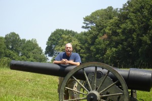 My husband, Jim, with cannon